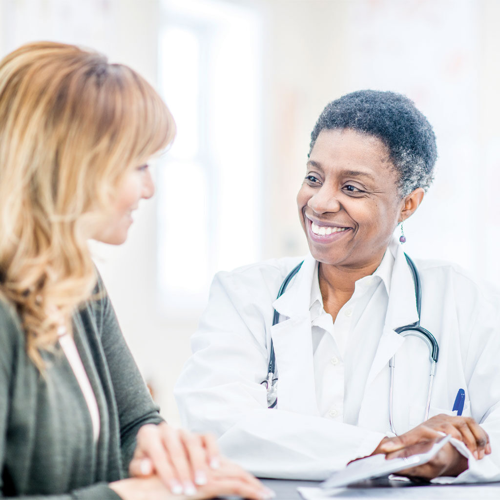 Doctor and patient consultation on Integrated Pain Relief in Denver