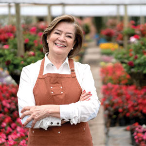 Woman smiling in garden section of store