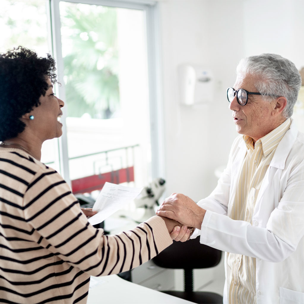 Woman and doctor shaking hands
